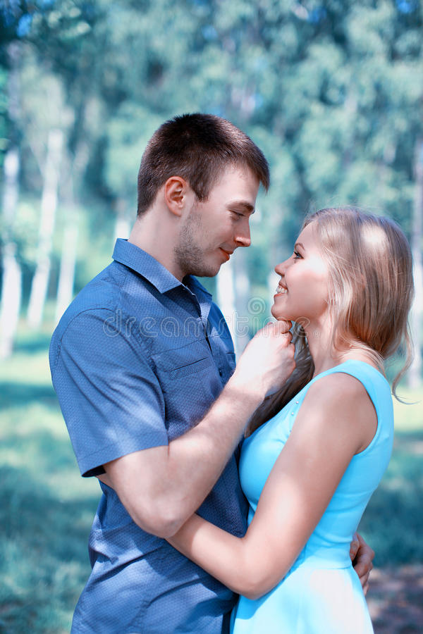 Beautiful sensual couple in love. Kiss moment stock photo