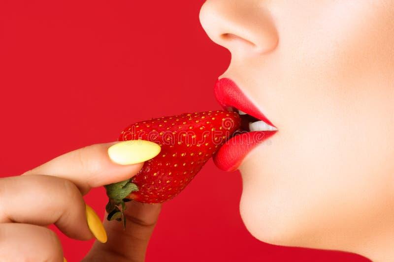 Beautiful sensual lips and strawberry royalty free stock image