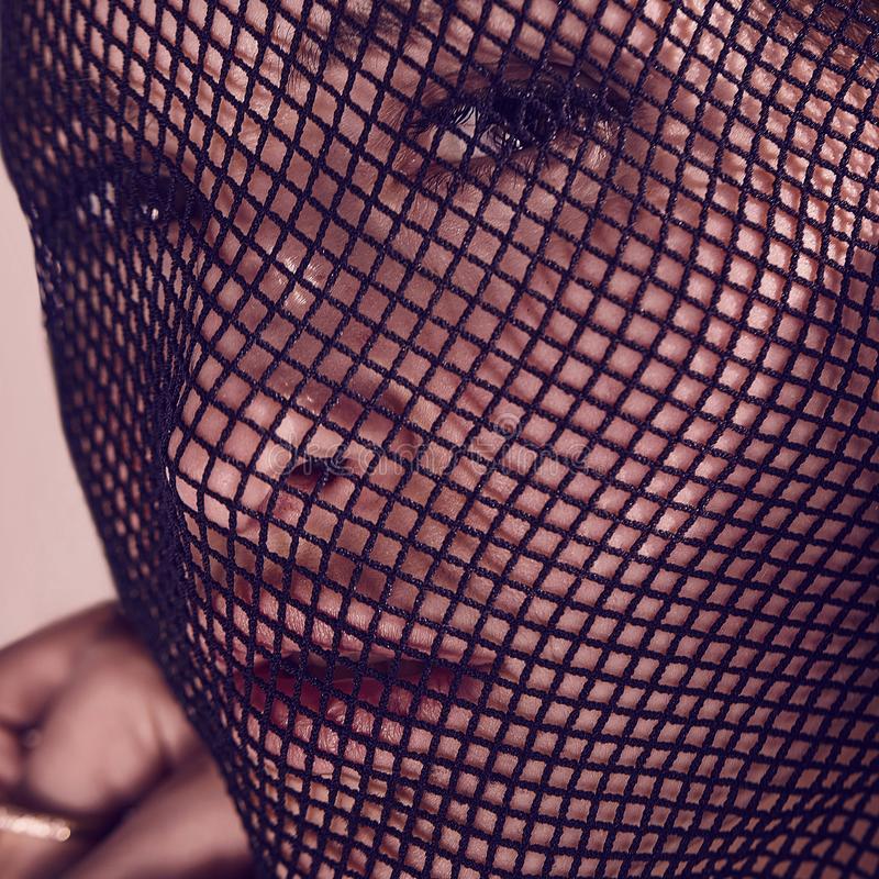 Beautiful sensual woman in a black veil on her face. royalty free stock image