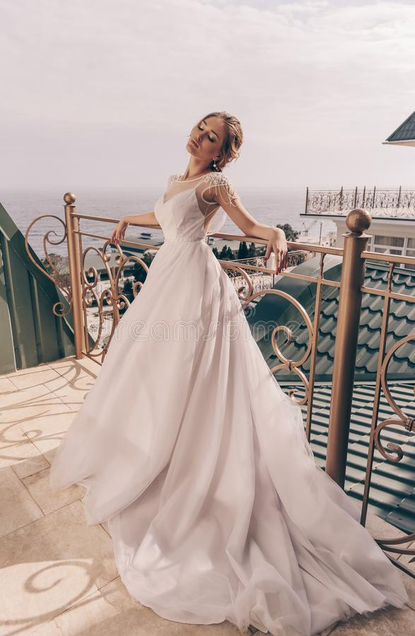 beautiful sensual woman with blond hair in luxurious wedding dress royalty free stock image