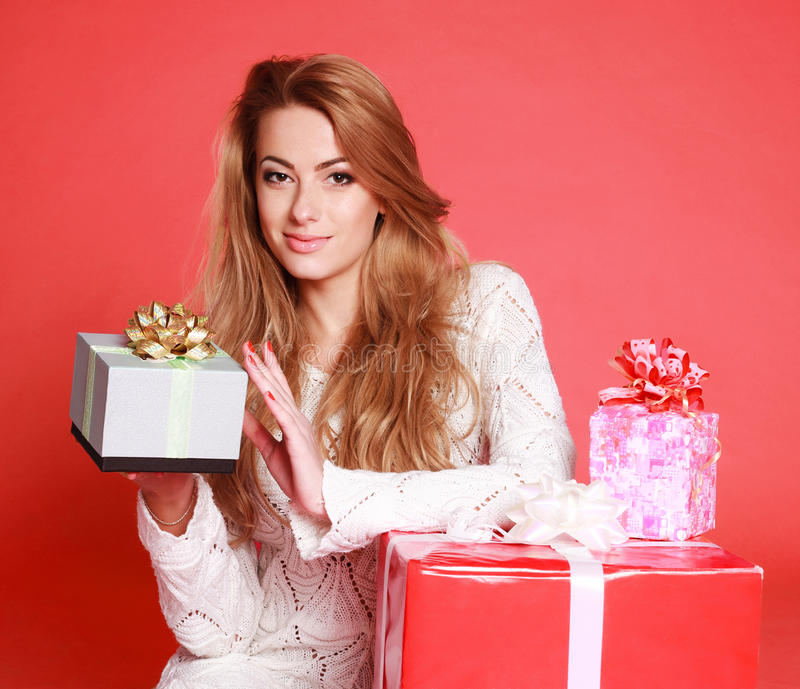 Beautiful sensual woman with christmas gifts stock photography
