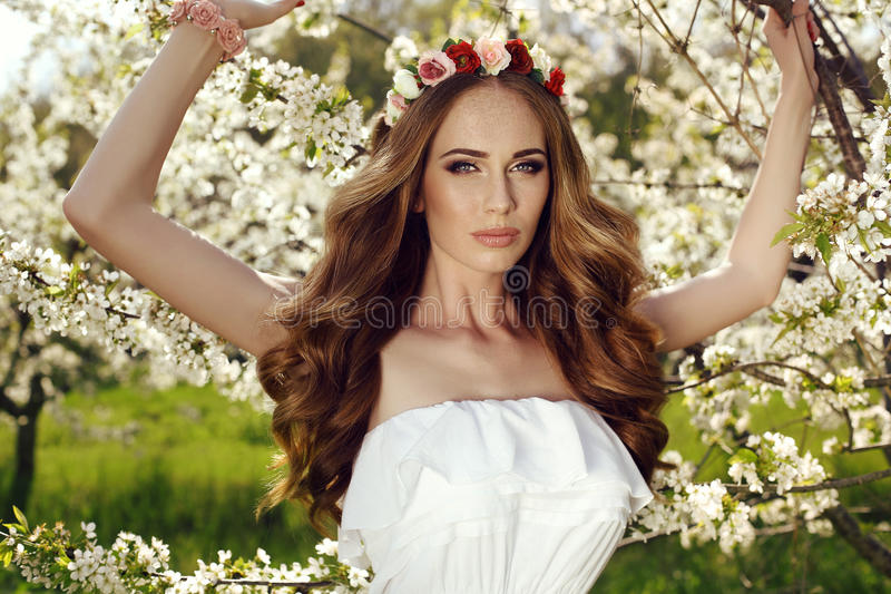 Beautiful sensual woman with long red hair and flower's headband. Fashion outdoor photo of beautiful sensual woman with long red hair and flower's headband stock images