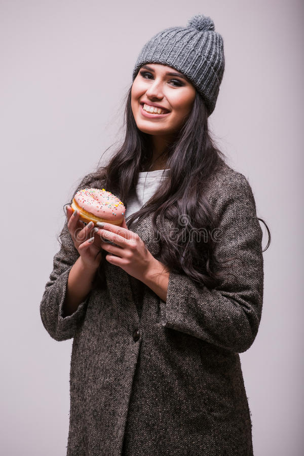 Beautiful sensual woman posin with donuts. On white background. Series of photos royalty free stock image