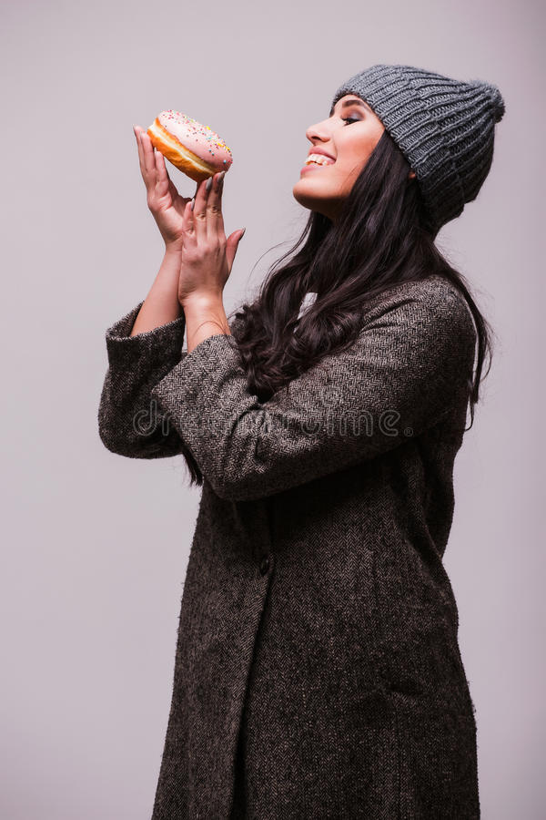 Beautiful sensual woman posing with donuts. Beautiful sensual woman posin with donuts on white background. Series of photos royalty free stock photography