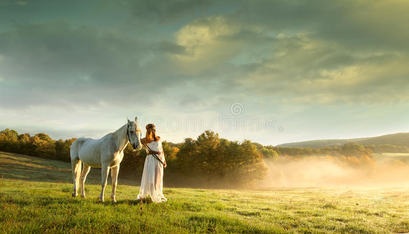 Beautiful sensual women with white horse royalty free stock image