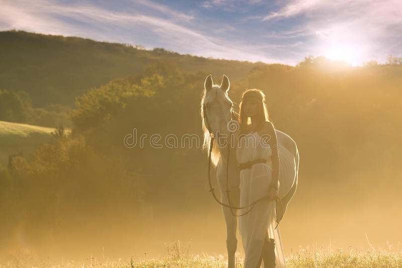 Beautiful sensual women with white horse royalty free stock photos