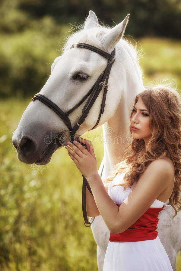 Beautiful sensual women with white horse stock images