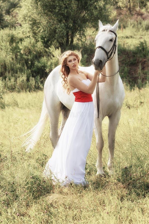 Beautiful sensual women with white horse stock photo