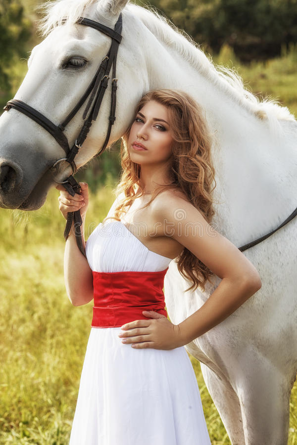 Beautiful sensual women with white horse stock image