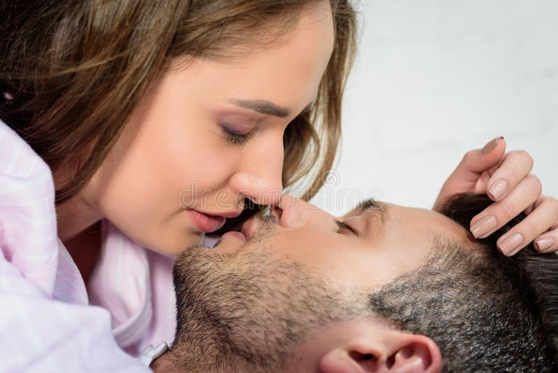 beautiful sensual young couple kissing royalty free stock photography