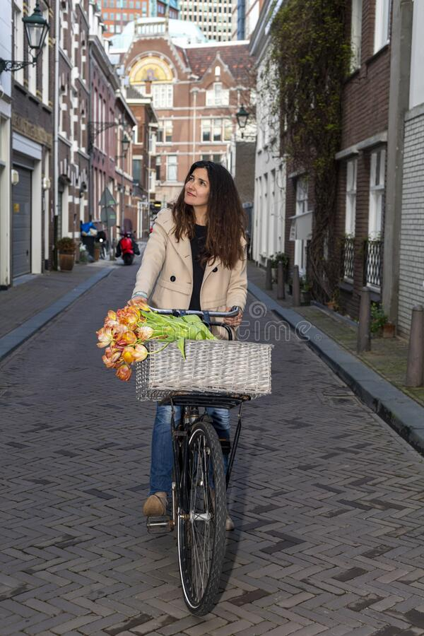 Beautiful sensuality elegance lady on bicycle. Beautiful sensuality elegance lady, brown happy, fun cheerful smiling woman in brown jacket, black t-shirt and stock photography