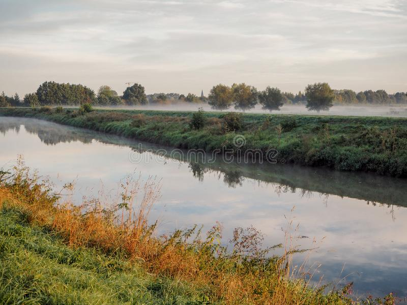 Beautiful September sunrise over the Mechels Broek nature park. And the river Dijle, just outside of Mechelen, Belgium stock photography