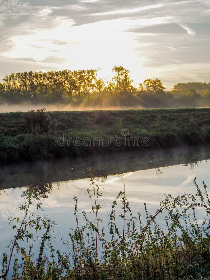 Beautiful September sunrise over the Mechels Broek nature park. And the river Dijle, just outside of Mechelen, Belgium royalty free stock images
