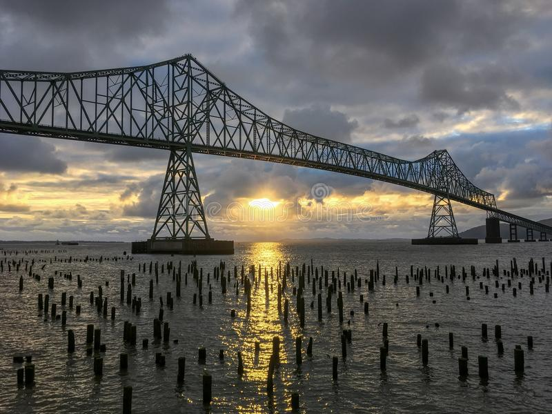 Beautiful serene Sunset Columbia River. Beautiful Sunset on the Columbia river silhouetting the Astoria-Megler Bridge always makes for a special scene stock photography