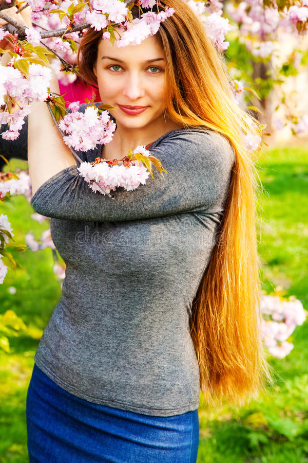 Beautiful serene woman and flower blossoms royalty free stock photography