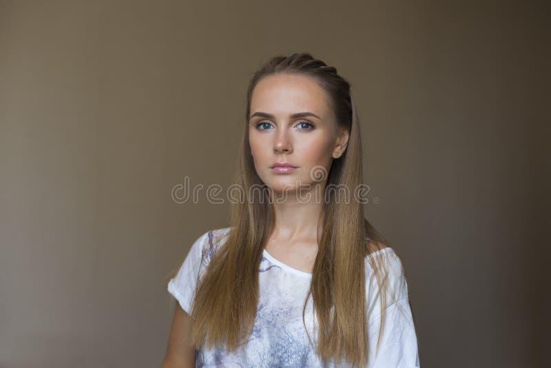 Beautiful serious blue eyed girl stock photo