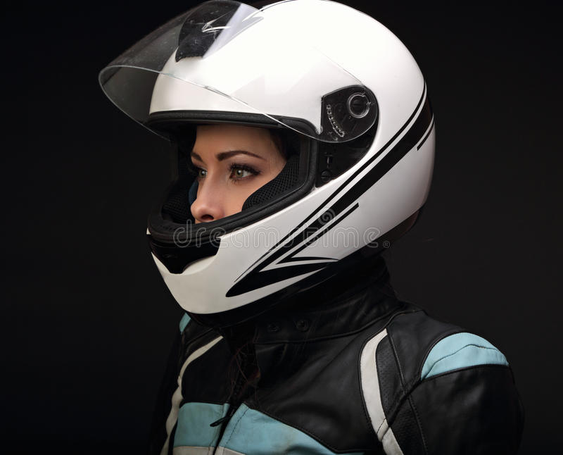 Beautiful serious makeup profile of rider woman looking in white royalty free stock photography