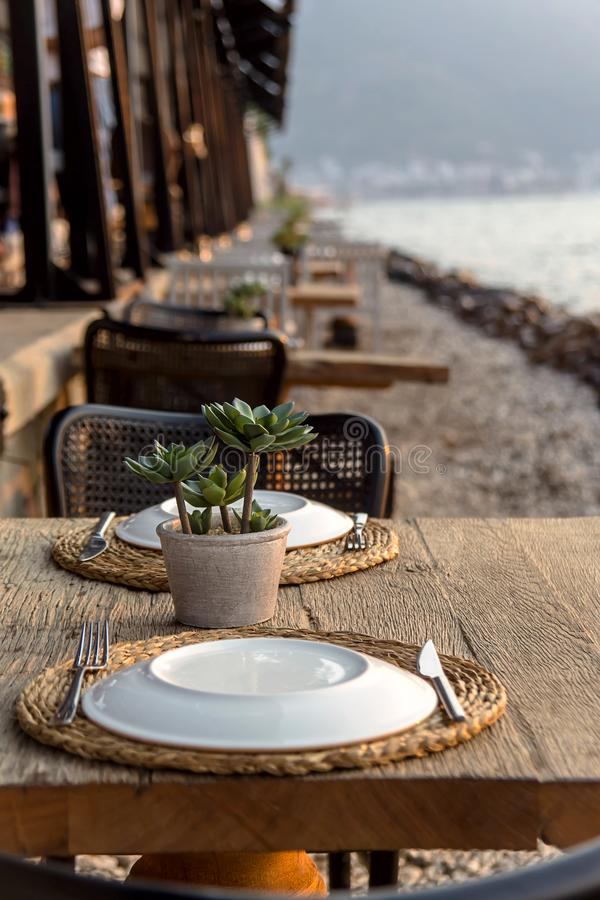Travel table for lunch or dinner by the sea stock photography