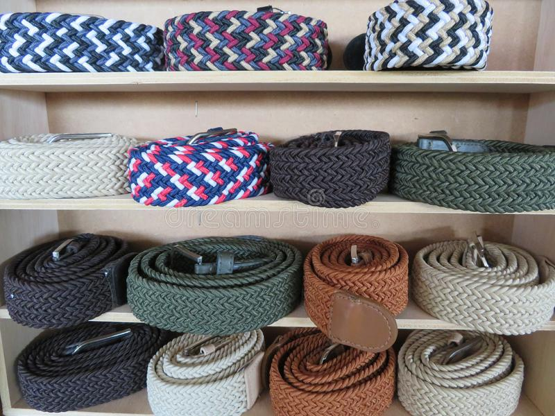 Beautiful set of belts of different models and colors stock photography
