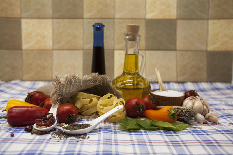 Beautiful set for the creation of the Sicilian pasta: cherry tomatoes, olive oil, balsamic sauce, garlic, spices, sea salt, salad royalty free stock photography