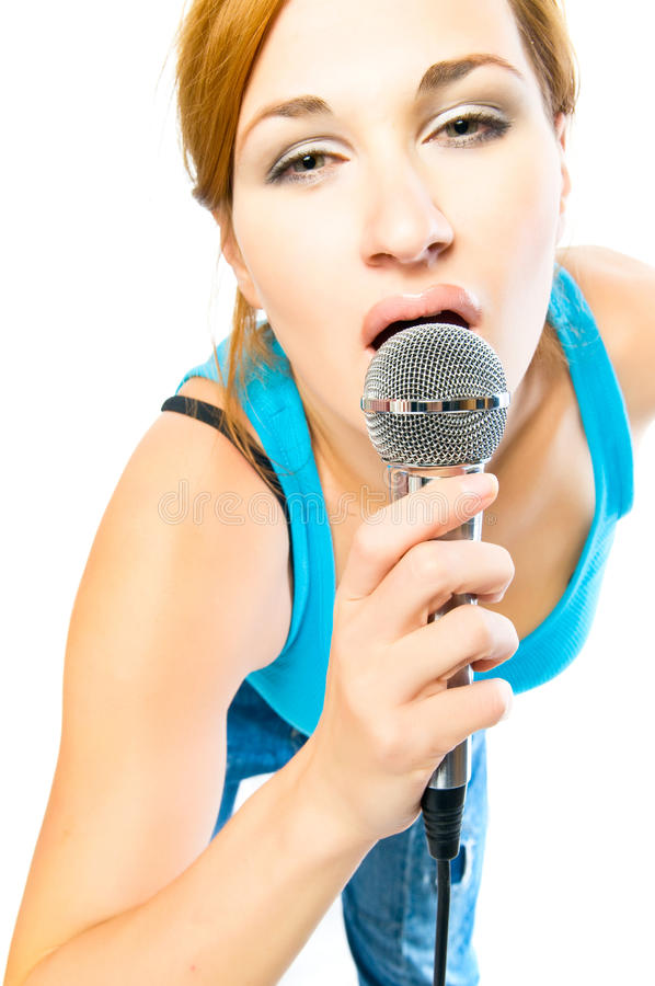 Beautiful sexual girl with a microphone royalty free stock photography