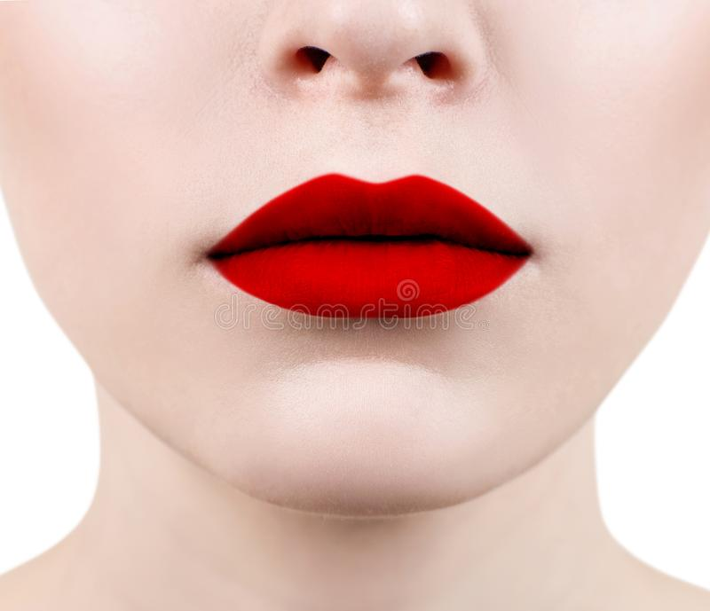 Beautiful sexual red lips closeup. Sensual mouth of young woman stock photo
