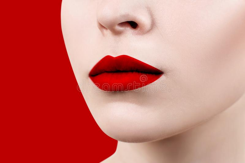 Beautiful sexual red lips closeup. Over red background royalty free stock photography