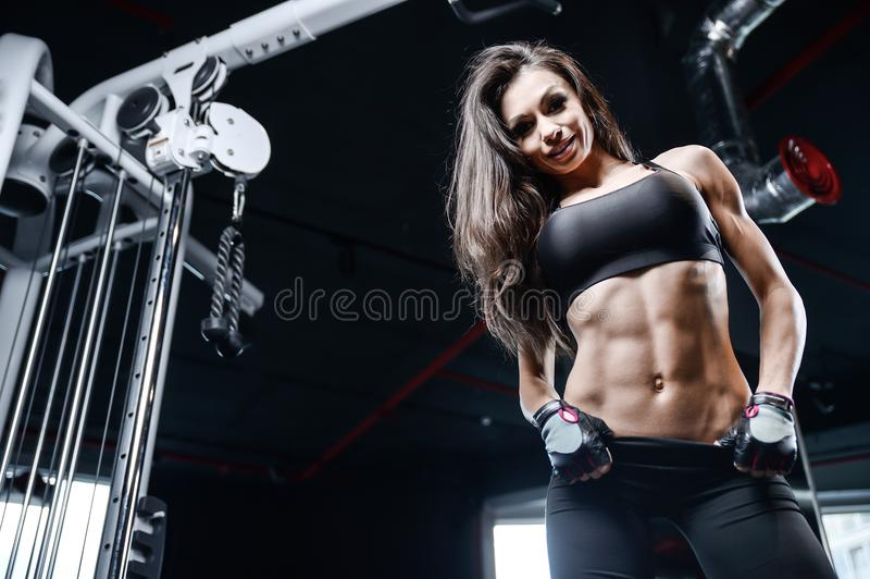 athletic young girl training abs in gym stock image