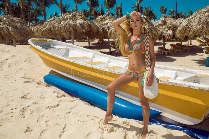 Beautiful sexy bikini woman, posing on the Caribbean beach stock photo
