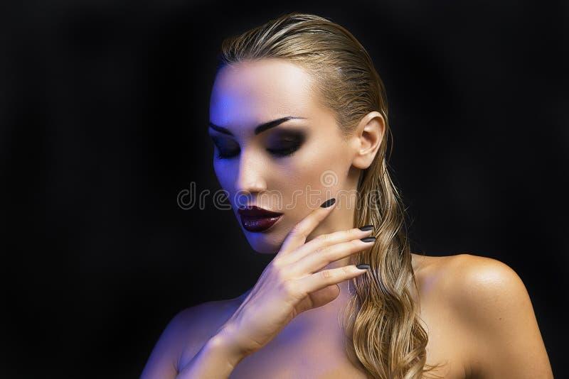 Beautiful Blond Woman. Dark Background. Bright Smokey Eyes royalty free stock photo