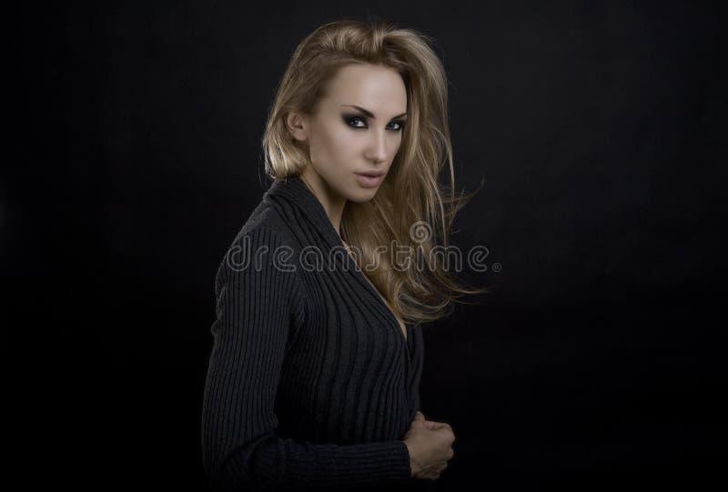 Beautiful Blond Woman. Dark Background. Smokey Eyes Makeup stock photography