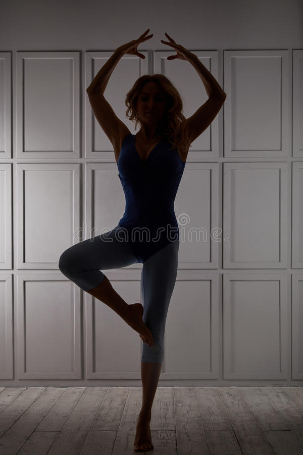 Beautiful blond woman wear casual comfort clothes for gym stock images