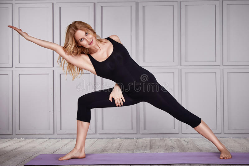 Beautiful blond woman wear casual comfort clothes for gym. Exercise fitness gymnastic dance ballet perfect body shape athletic catalog collection clothes for stock photos