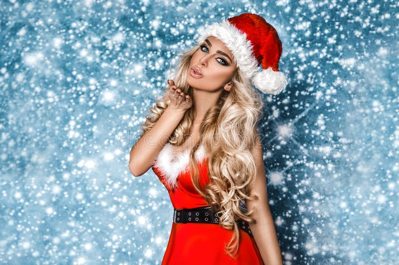 Beautiful sexy blonde female model dressed in a Santa Claus hat stock photos