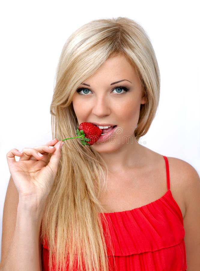 Beautiful blonde girl with red strawberry stock photos
