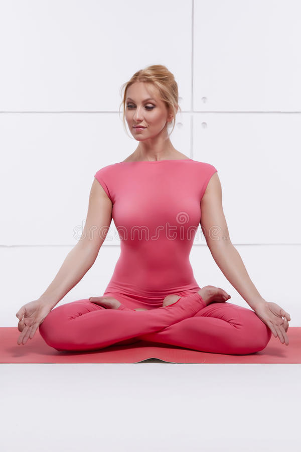 Beautiful blonde perfect athletic slim figure engaged in yoga, pilates, exercise or fitness, lead healthy lifestyle, and stock images