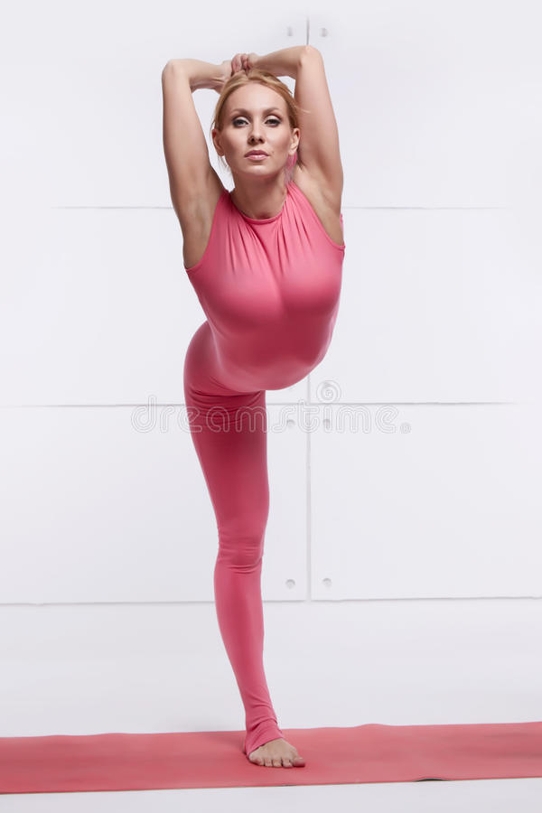 Beautiful blonde perfect athletic slim figure engaged in yoga, pilates, exercise or fitness, lead healthy lifestyle, and stock image