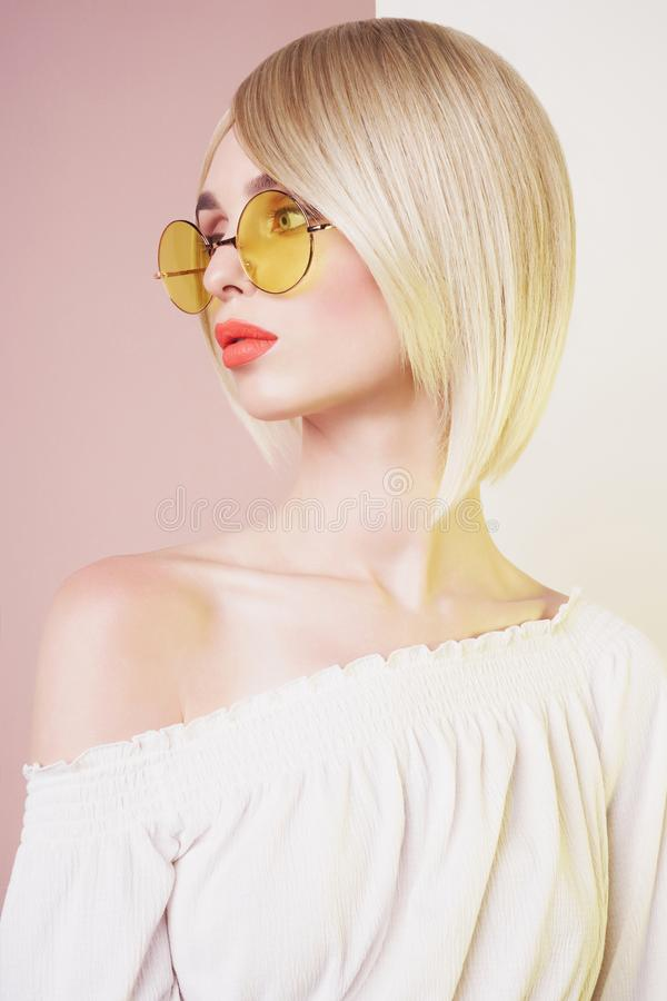 Sensual stylish woman in erotic white dress. Blue-eyed lady with perfect lips in modern colour sunglasses. Beautiful sexy blonde with professional classic make stock photo