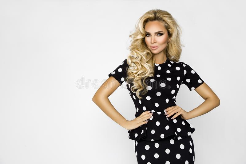 Beautiful, blonde woman in elegant clothes in polka dots stock images