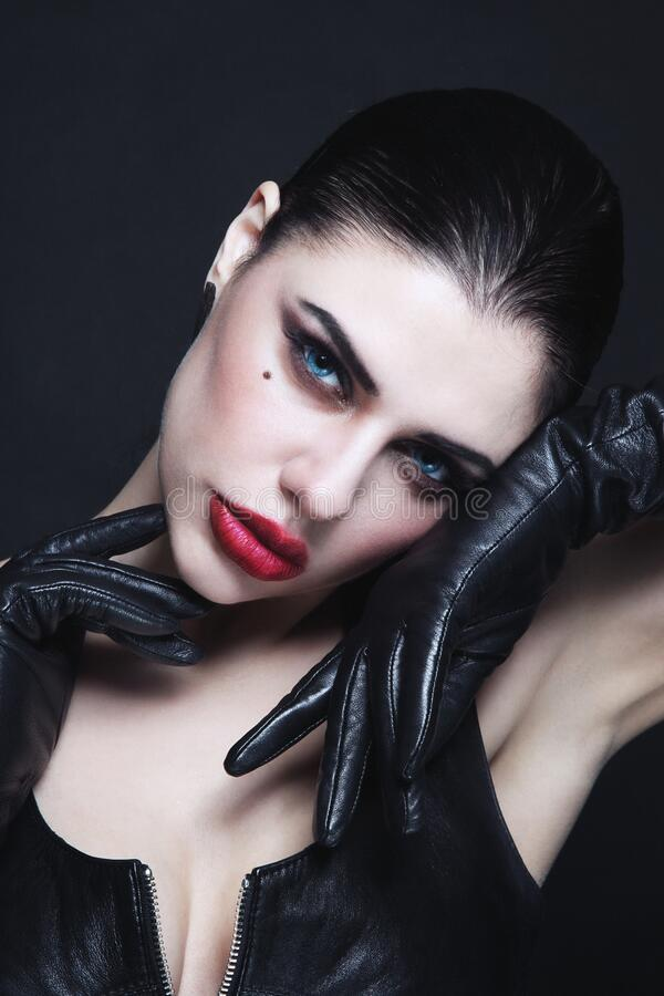 Free Beautiful Sexy Brunette With Fancy Makeup And Leather Gloves Royalty Free Stock Image - 186293986