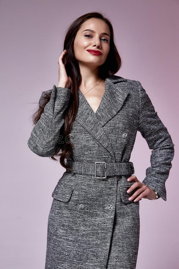 Beautiful brunette woman business office style fashion clothes summer fall collection perfect body shape pretty face makeup. Smile wear black dress coat skirt stock images