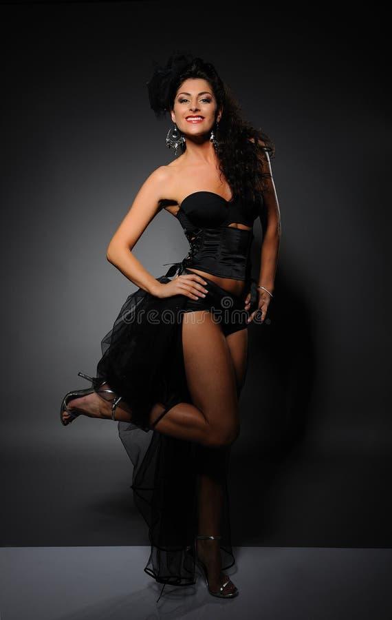 Beautiful cabaret girl dancing stock images