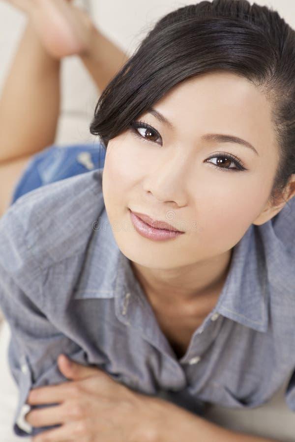 Beautiful Chinese Asian Woman Laying Down royalty free stock image