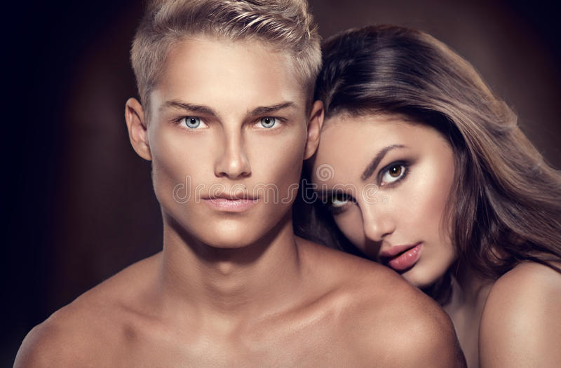 Beautiful couple portrait. Model men with his girlfriend posing together
