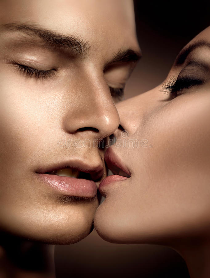 Beautiful couple. Young men and beauty young women kissing