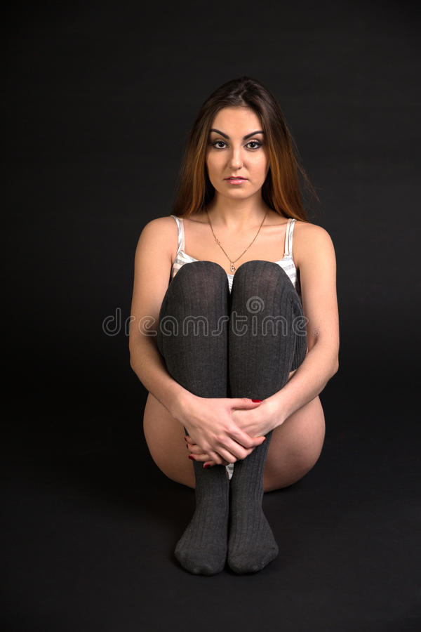 Beautiful fit woman sitting on the floor stock photos