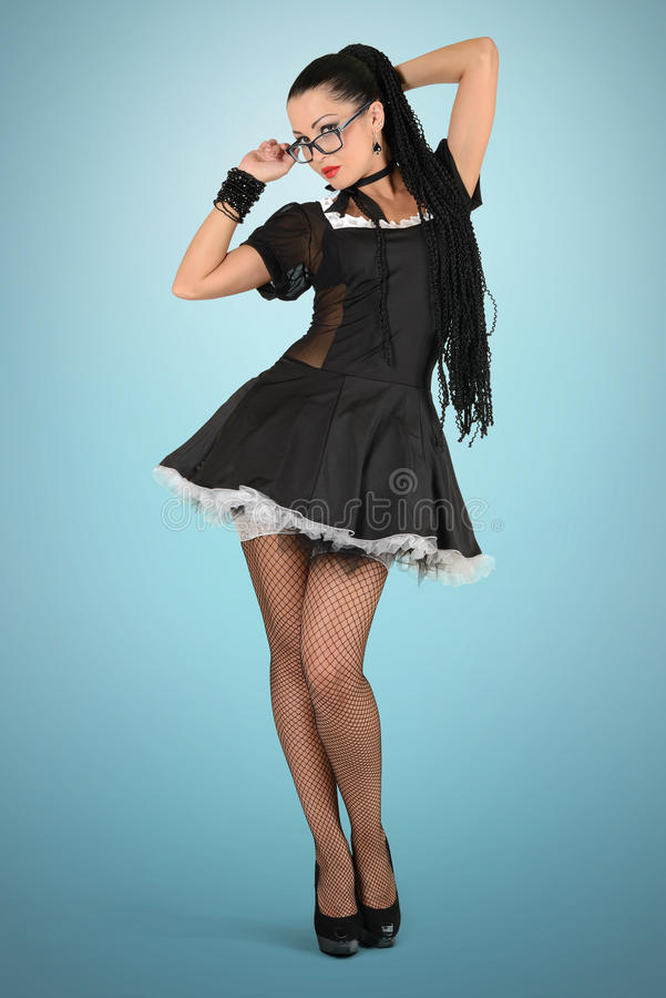 Beautiful french maid with glasses royalty free stock photography