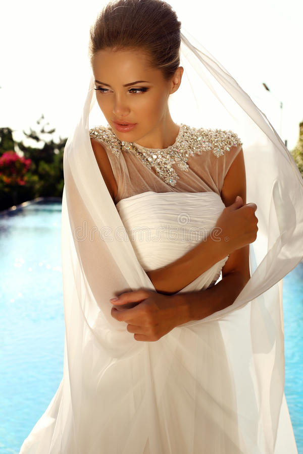 Beautiful girl with blond hair in elegant wedding dress stock images