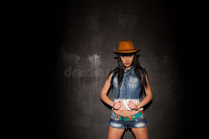 Beautiful girl in cowboy hat and denim stock images