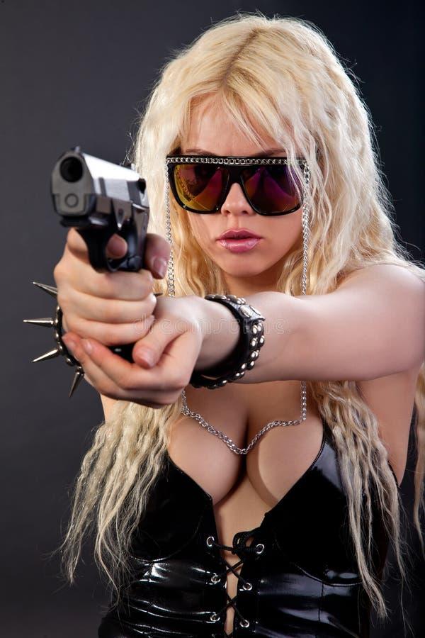 Beautiful girl with gun stock image